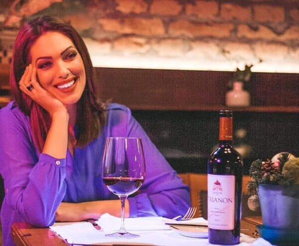 Girl drinking Trianon 2016 wine